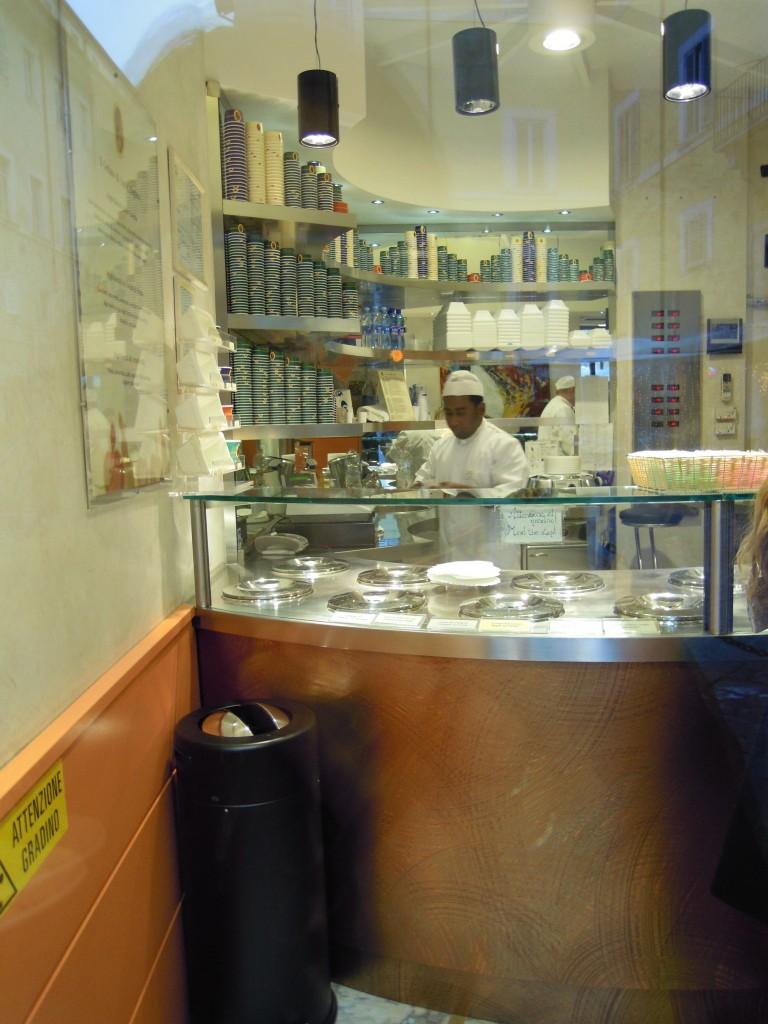 man with white hat behind gelato counter