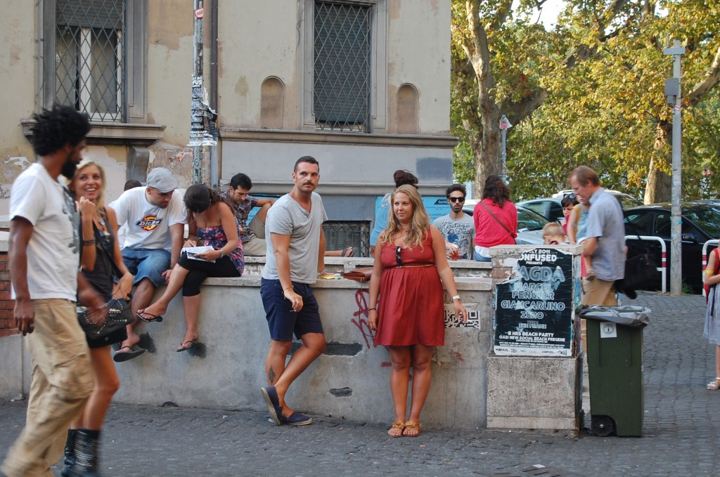 Young people on a sunny day in front of Freni e Frizioni in Trastevere