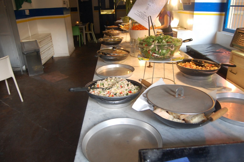 cous cous and salad on a buffet table for the Freni e Frizioni aperitivo