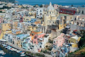 view of colorful houses in corricella procida a top place to stay on the island