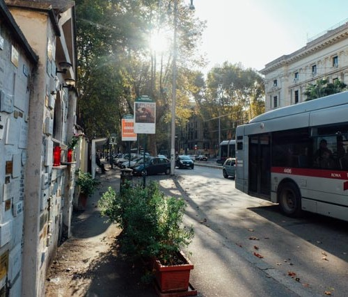 Bus driving down the street in Rome