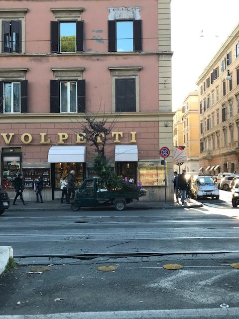 exterior of building on Rome street with Volpetti sign in gold