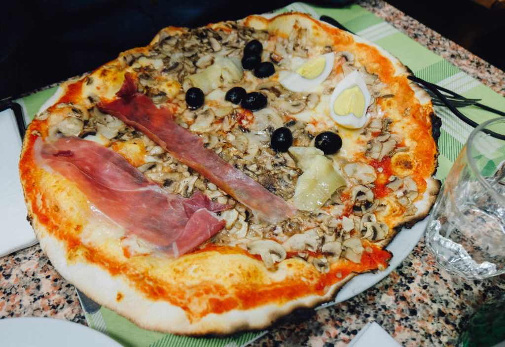 pizza with prosciutto and mushroom and egg