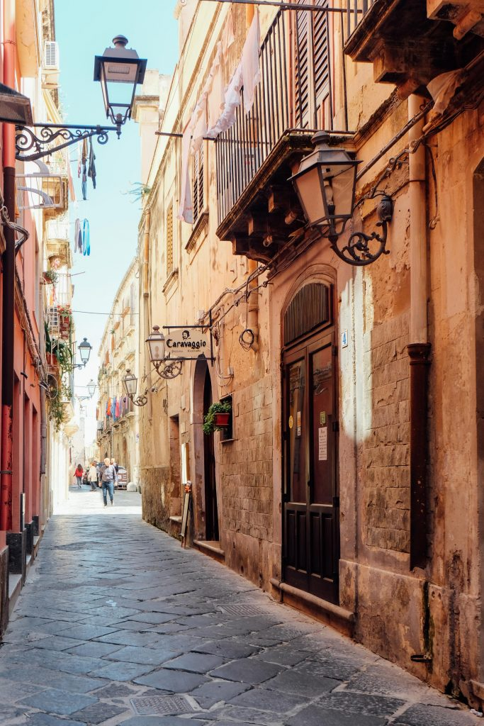 looking down a narrow street in Sicily