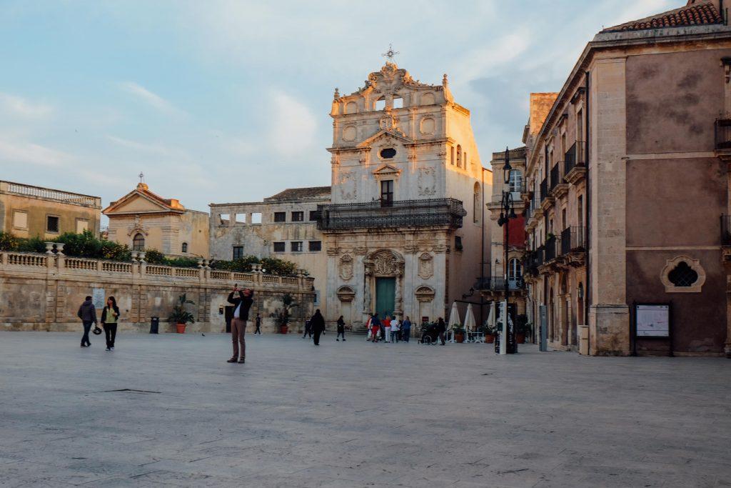 people in the main church square in Ortigia Sicily