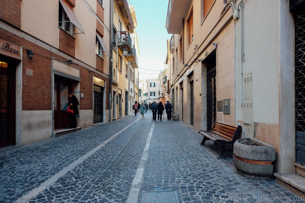 The main street in Palestrina Italy with groups of people walking
