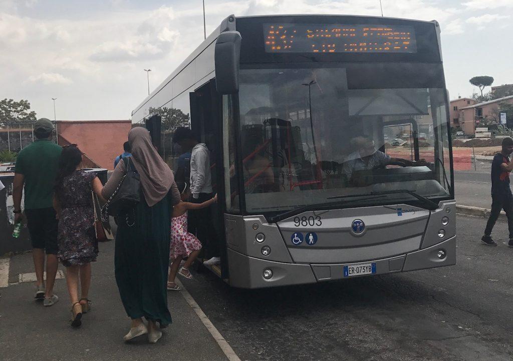 people boarding rome bus