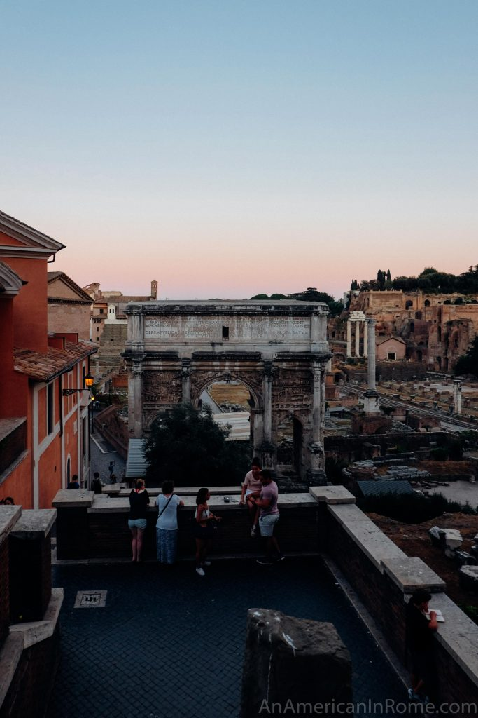 sunset over an arch in the Roman forum