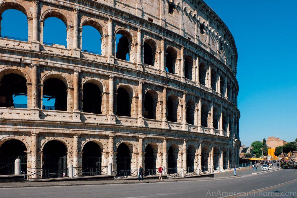exterior of colosseum with blue sky