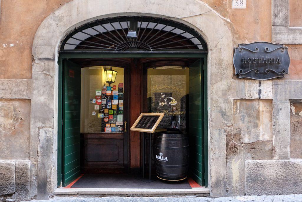 the entrance to al pompiere restaurant in rome