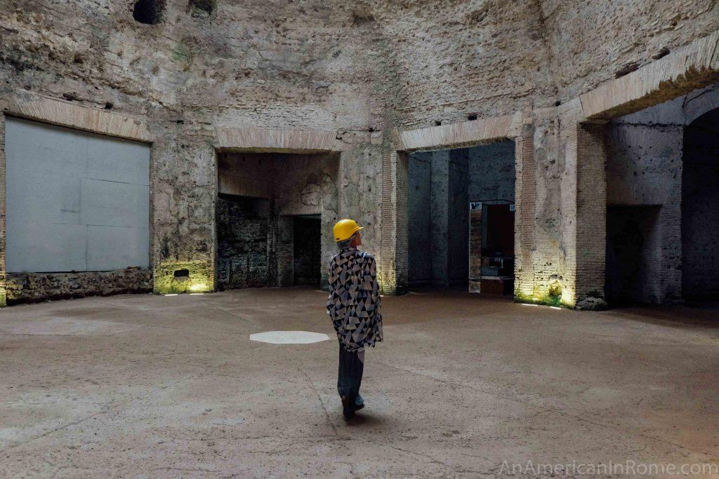 woman in hard hat inside roman ruins