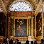 Three dark Caravaggio paintings inside San Luigi dei Francesi in Rome
