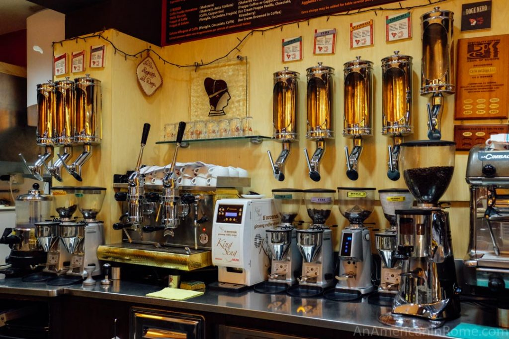 Coffee beans of different roasts and a neapolitan machine at Caffe del Doge in Venice