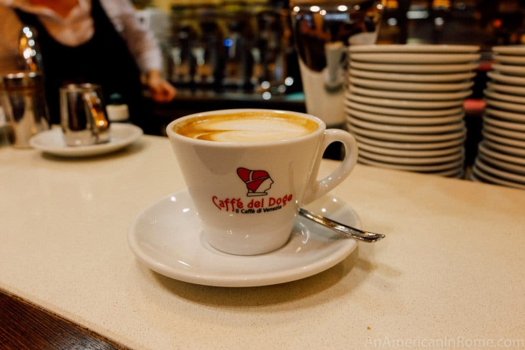 Cappuccino in a cup that reads Caffe del Doge