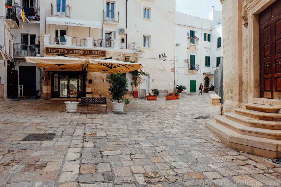 piazza in Monopoli Italy in Puglia with white awning outside a restaurant