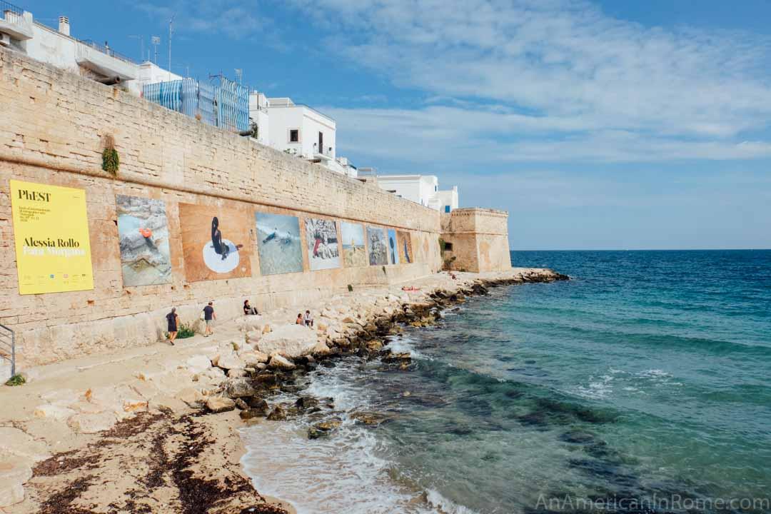 rocky beach along the wall of Monopoli Puglia