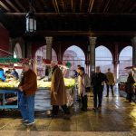 customers shopping for seafood at the rialto market