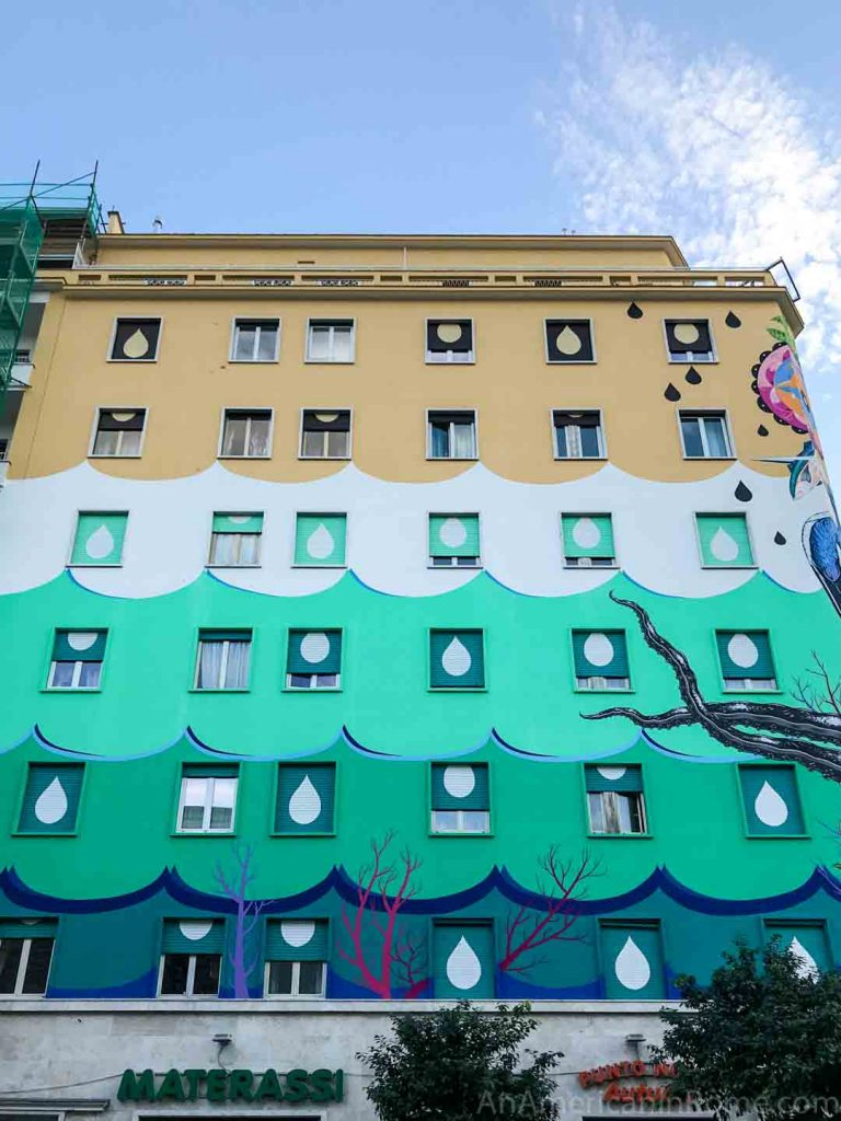 air cleaning street art in Rome that covers the shutters of the apartment building in Ostiense