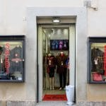 entrance to leather store in Rome with display windows