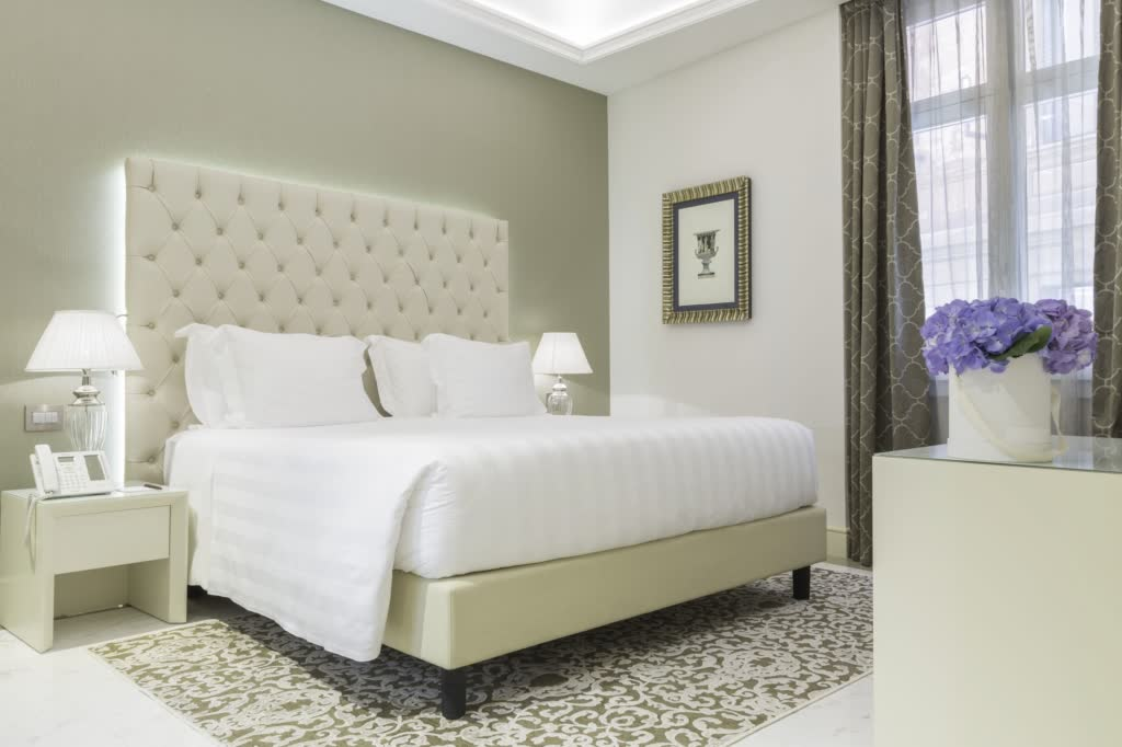 Aleph romantic hotel in Rome neutral bedroom with contemporary headboard