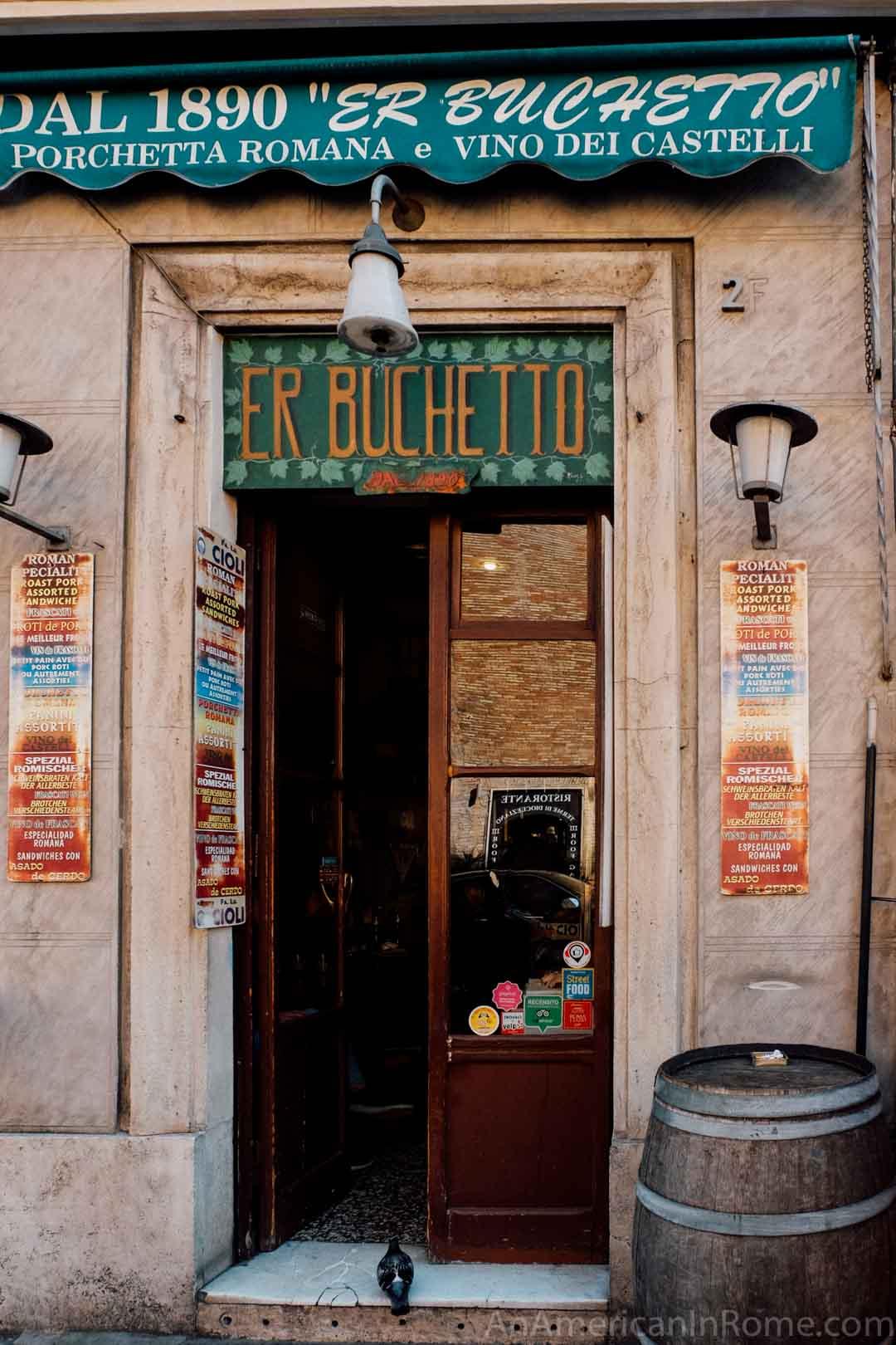 doorway to small porchetta shop er buchetto in rome