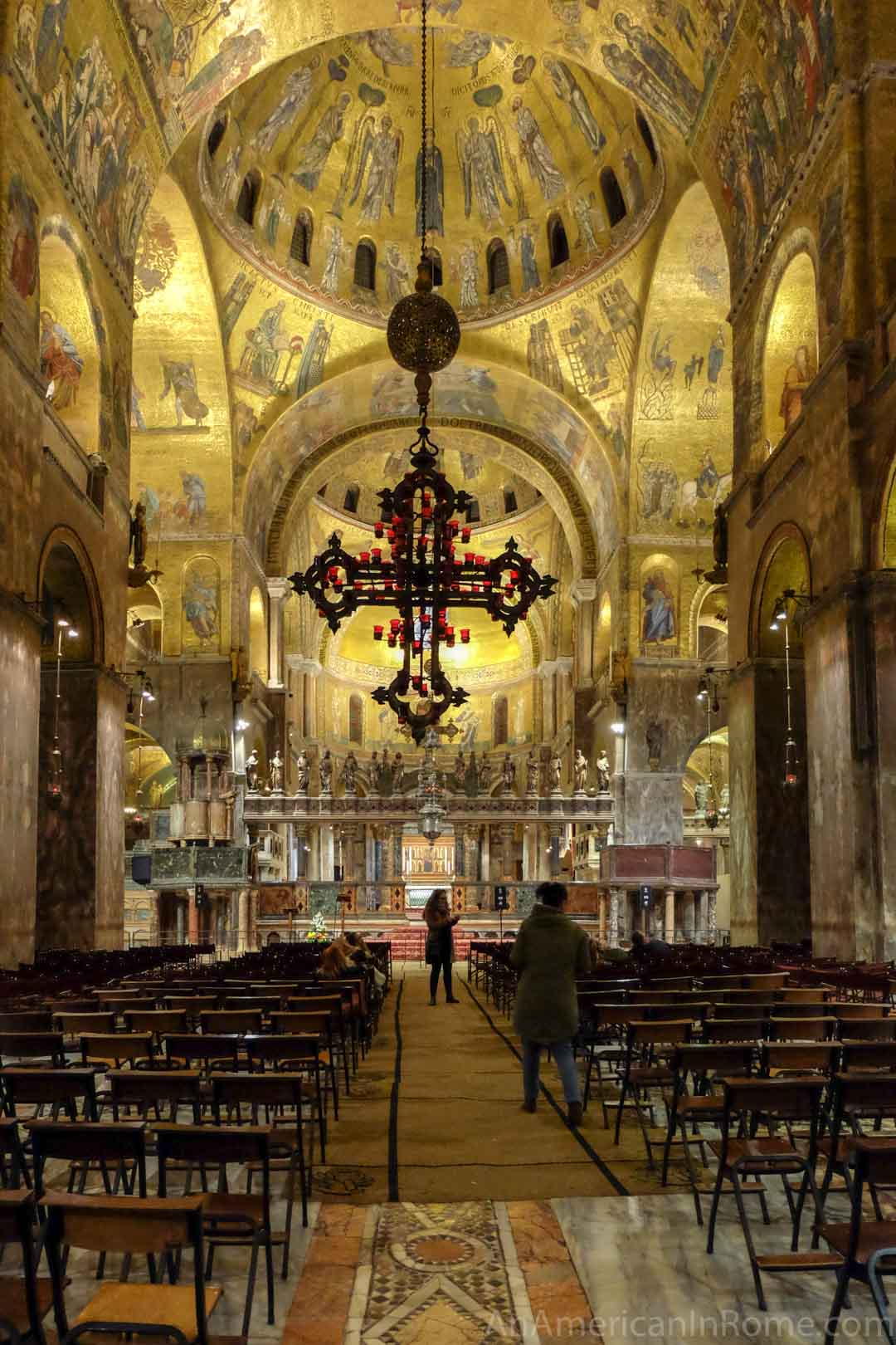 inside st. marks at night with a small group
