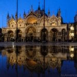 reflection of st marks basilica in acqua alta at night