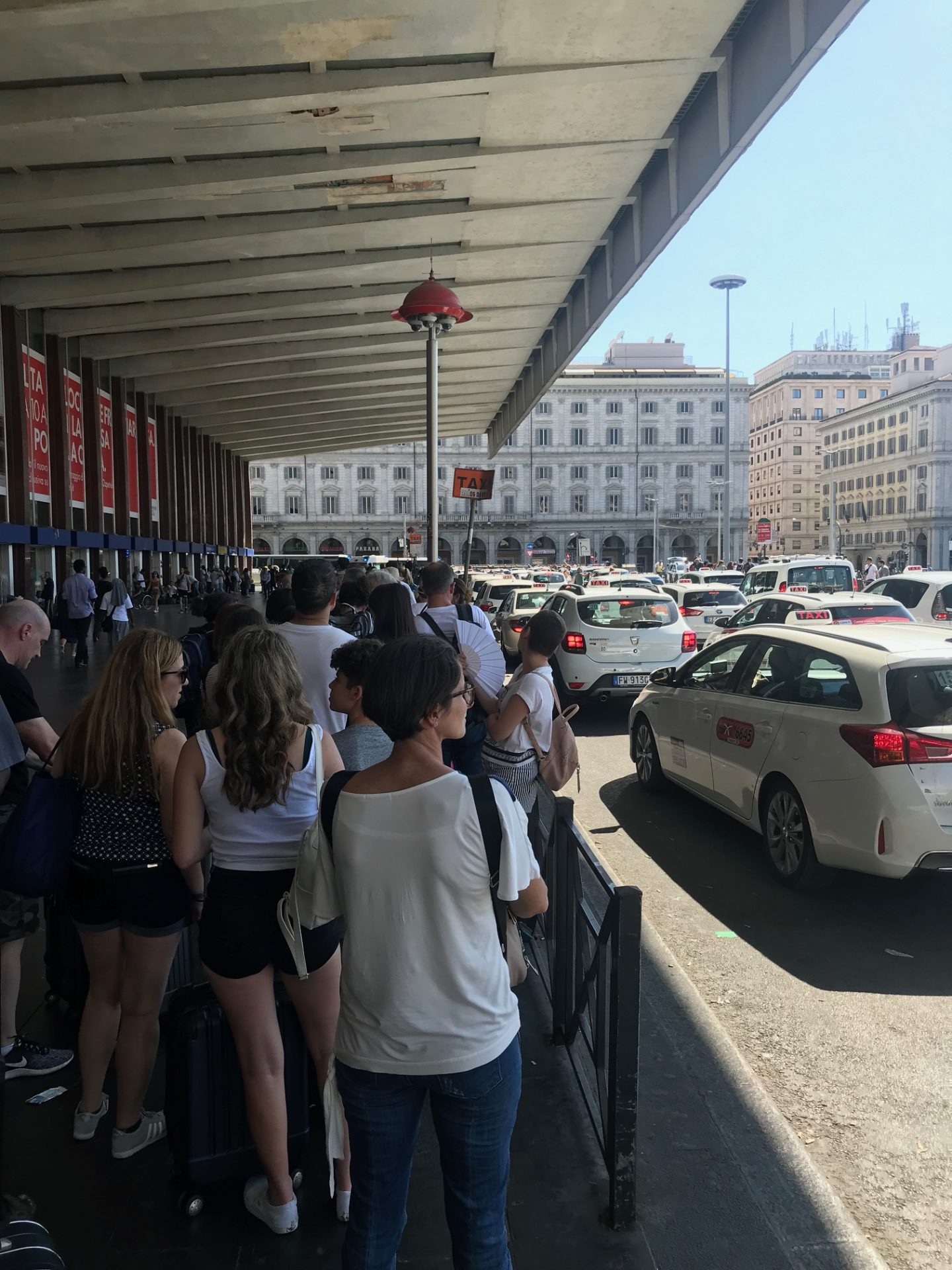 people waiting for a taxi during a strike in rome