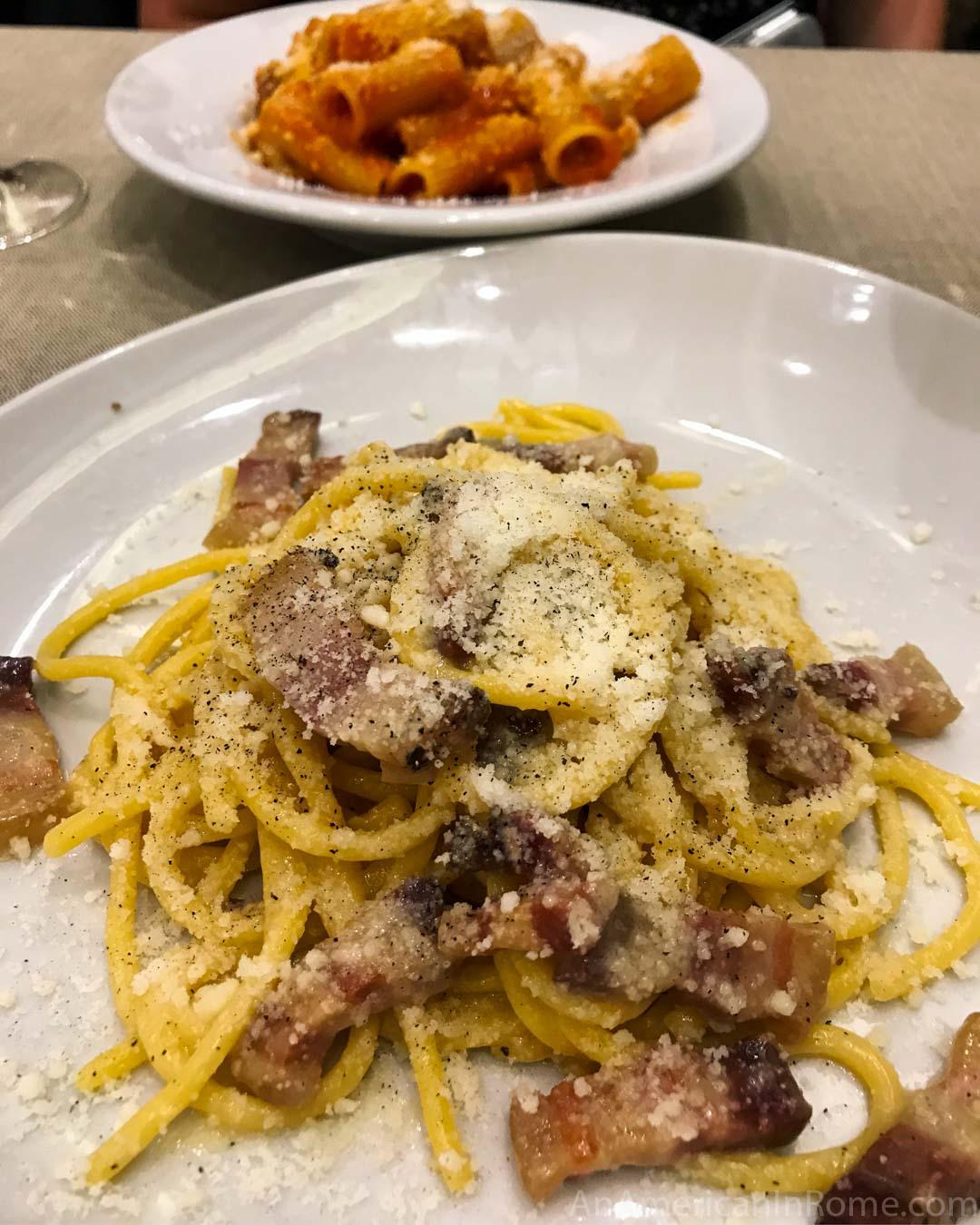 gricia pasta on white plate at La Tavernaccia