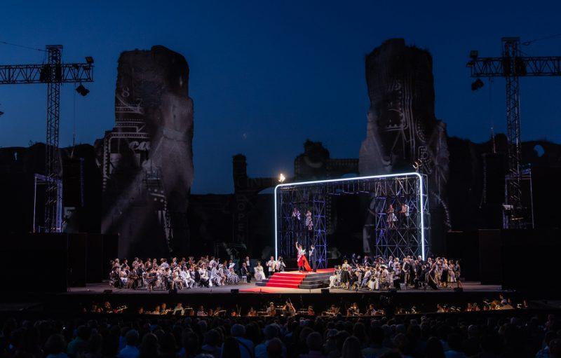 opera performers against dark sky and ruins