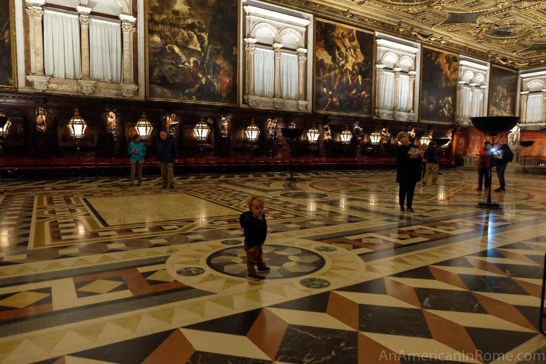child in the hall of Scuola Grande di San Rocco