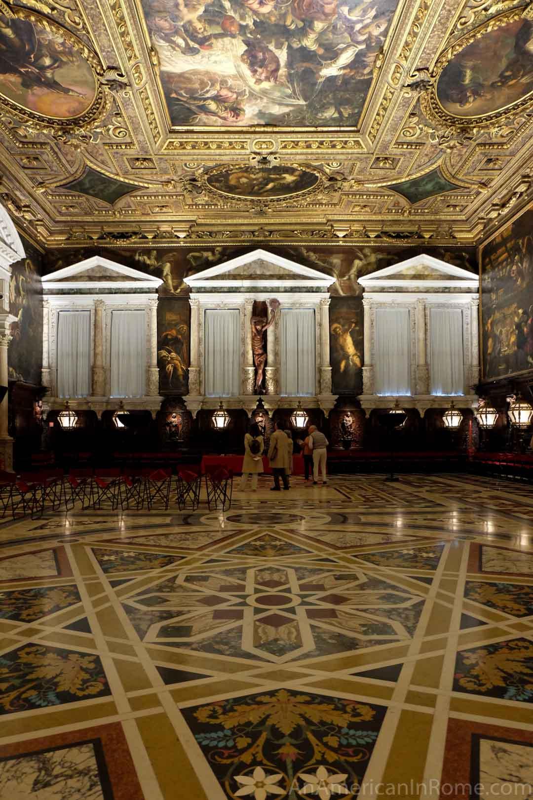 elaborate hall with three windows at Scuola Grande di san Rocco