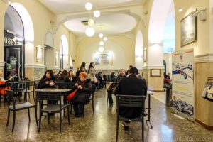 inside Fassi gelato where people eat ice cream at tables