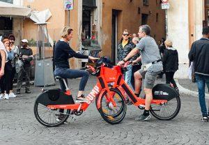 two people try bike rental rome