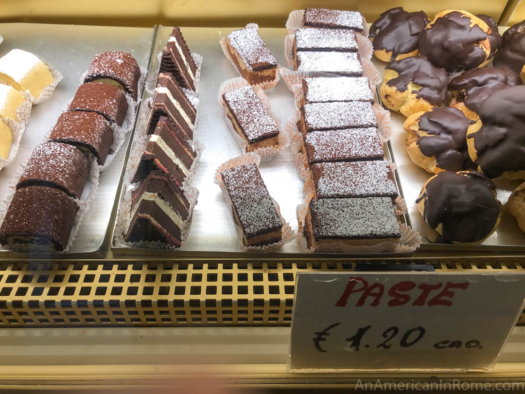 chocolate pastries behind glass at Pasticceria Tonolo