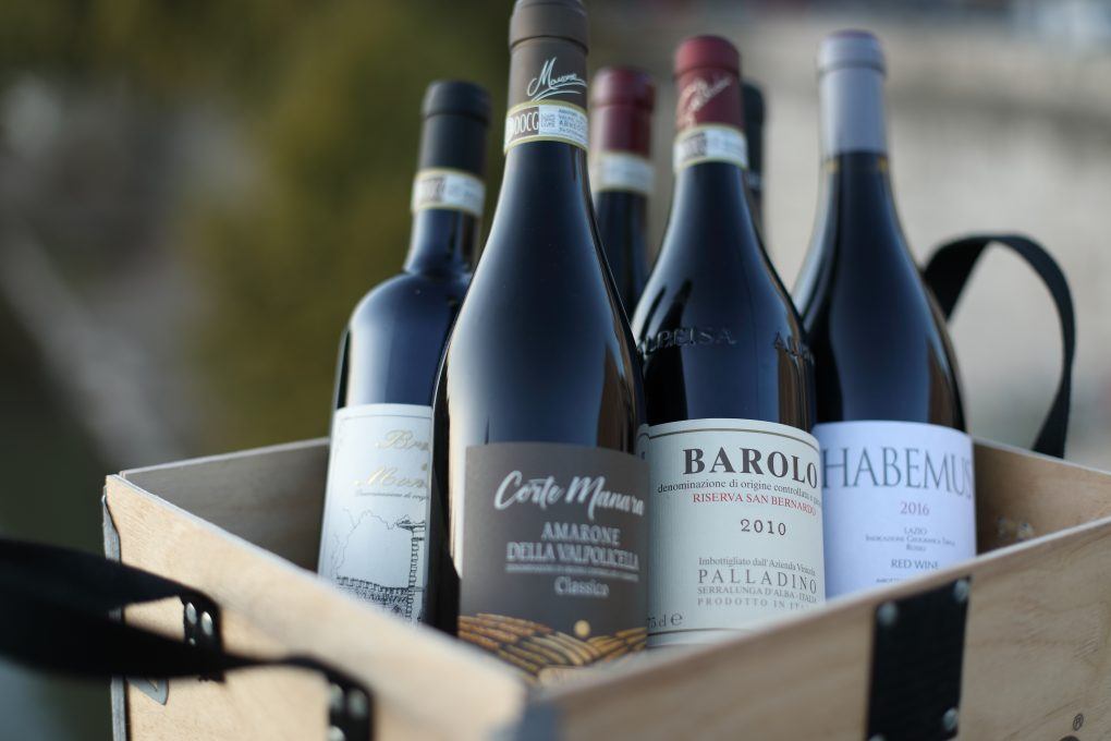 bottles of wine in wooden box with handles