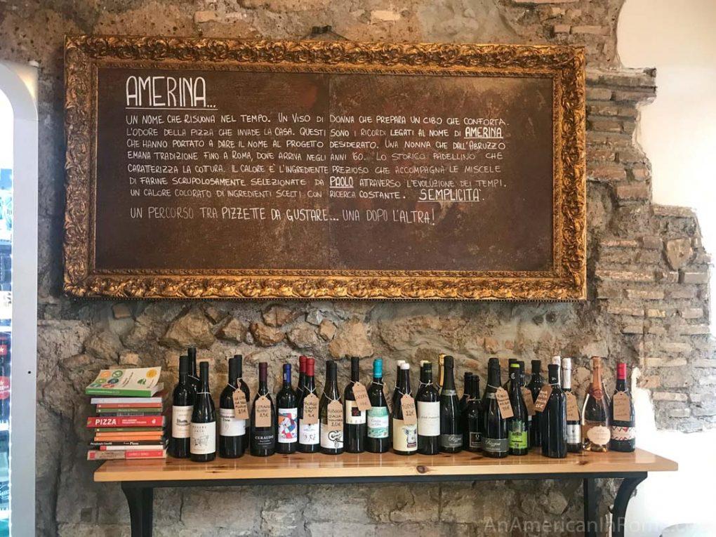 wine bottles under amerina sign