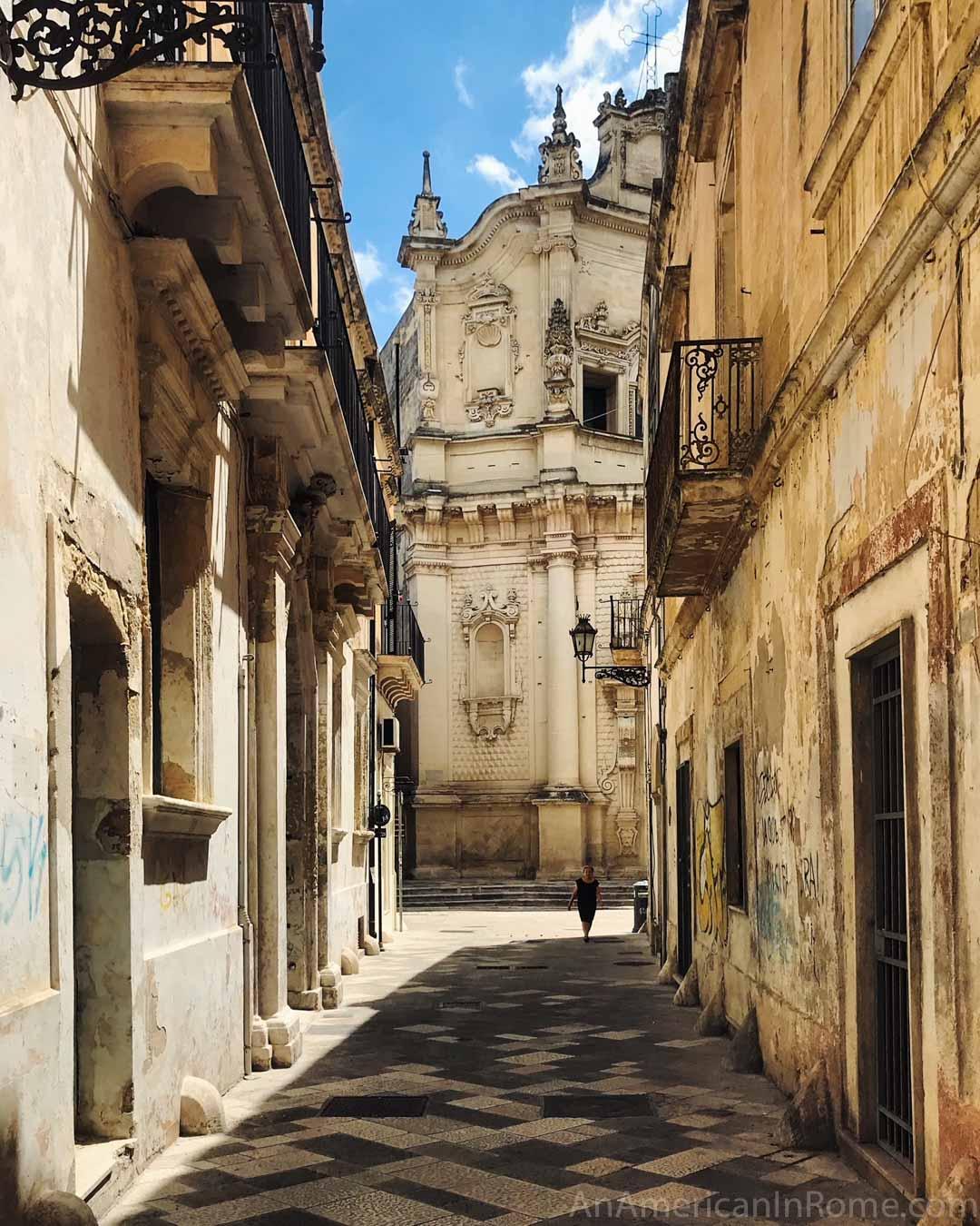 narrow street and church in Puglia